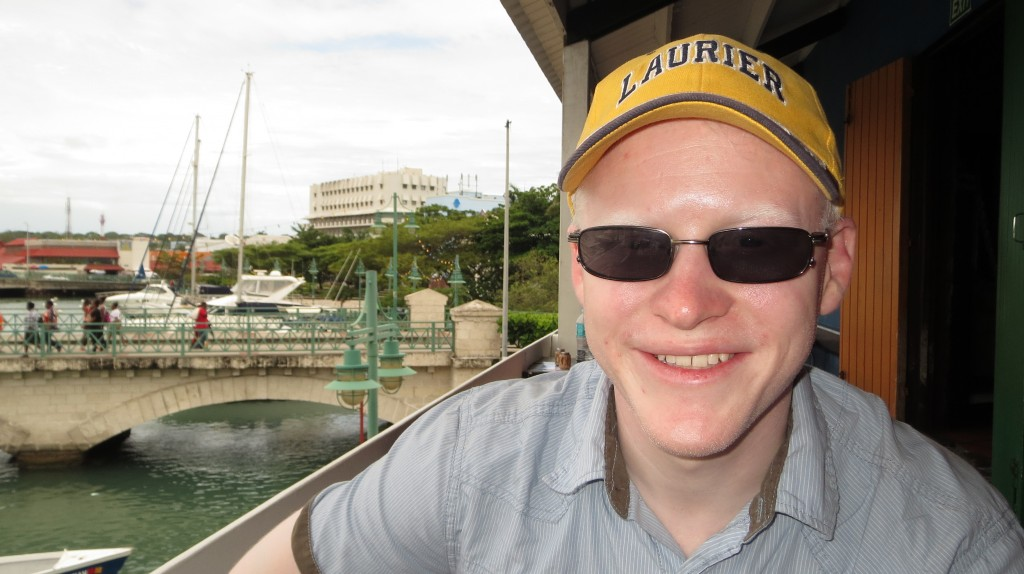 Dave smiles while waiting for lunch at the pub overlooking the port of Bridgetown.