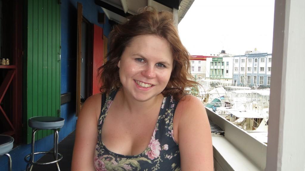 Rebecca smiles at the pub in Bridgetown.