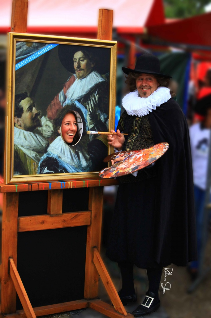 "A painter poses for a photo with a young woman whose face he's ""painting"""