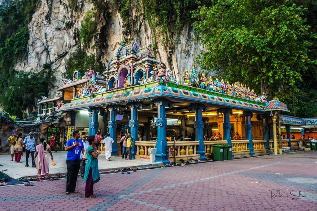People remove their shoes at the Batu Caves.